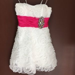 White strapless mini, raised flowers, pink belt